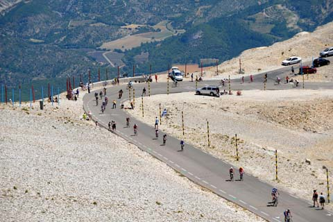 Racing cyclists ride on July 20, 2009 on the Mont Ventoux, southeastern France, during the amateur cycling race Montelimar-Mont Ventoux modeled on the Tour de France last stage but one. French Dimitri Champion won ahead of French Jean-Marc Bideau and Jimmy Turgis. The race gathered together 8,500 racing cyclists from 50 different nationalities AFP PHOTO / JEAN-PIERRE CLATOT (Photo credit should read JEAN-PIERRE CLATOT/AFP/Getty Images)